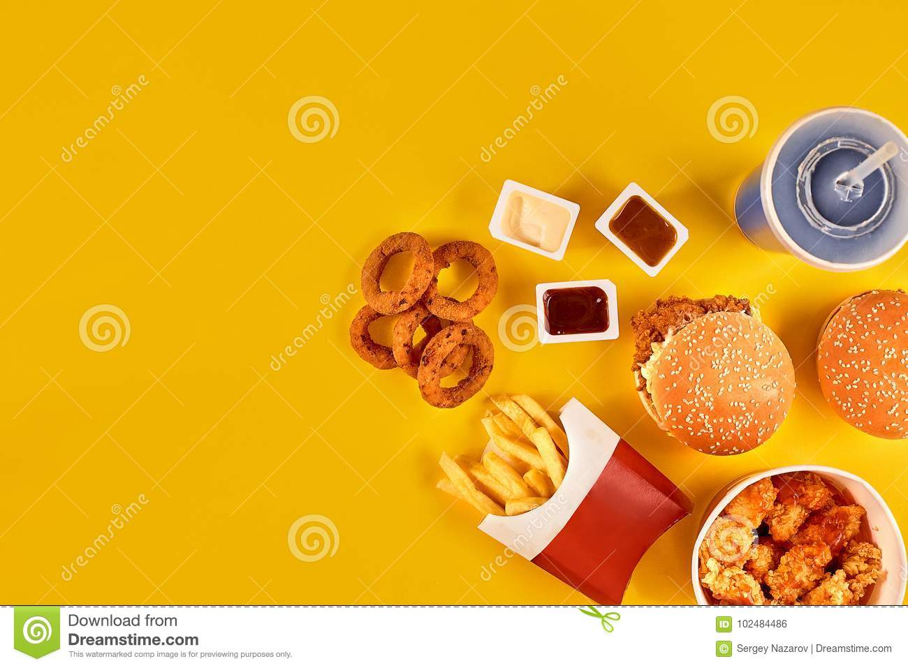 Take Away Composition French Fries Hamburger Mayonnaise And Ketchup Sauces On Yellow Background Menu Or Receipt