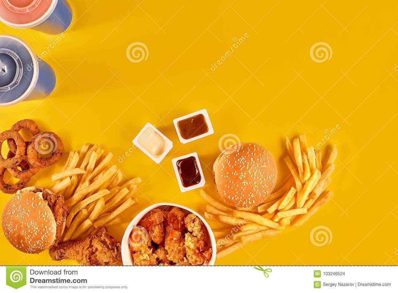 Take Away Composition French Fries Hamburger Mayonnaise And Ketchup Sauces On Yellow Background Menu Or Receipt Top View Copy Space