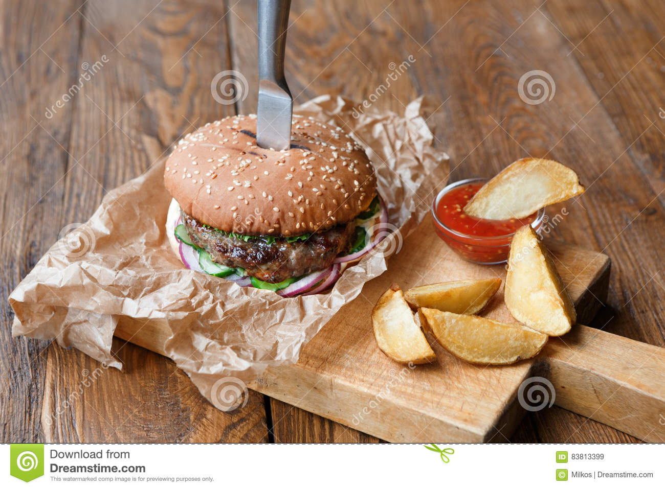 Fast food on restaurant wooden table burger and potato for Table burger