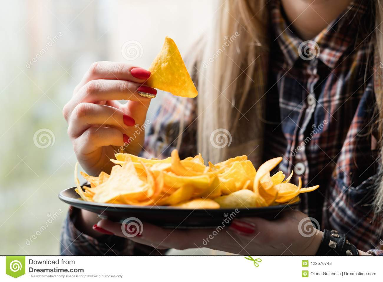 Fast food snack bad habit woman eat chips