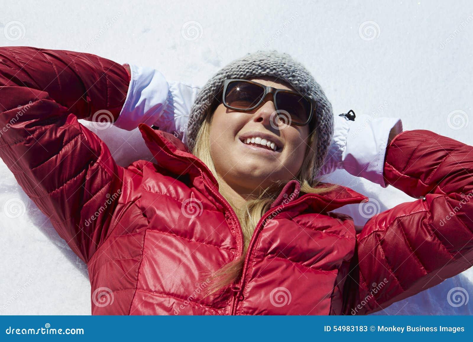 Fast utgift som skjutas av kvinnan som har gyckel på vinterferie