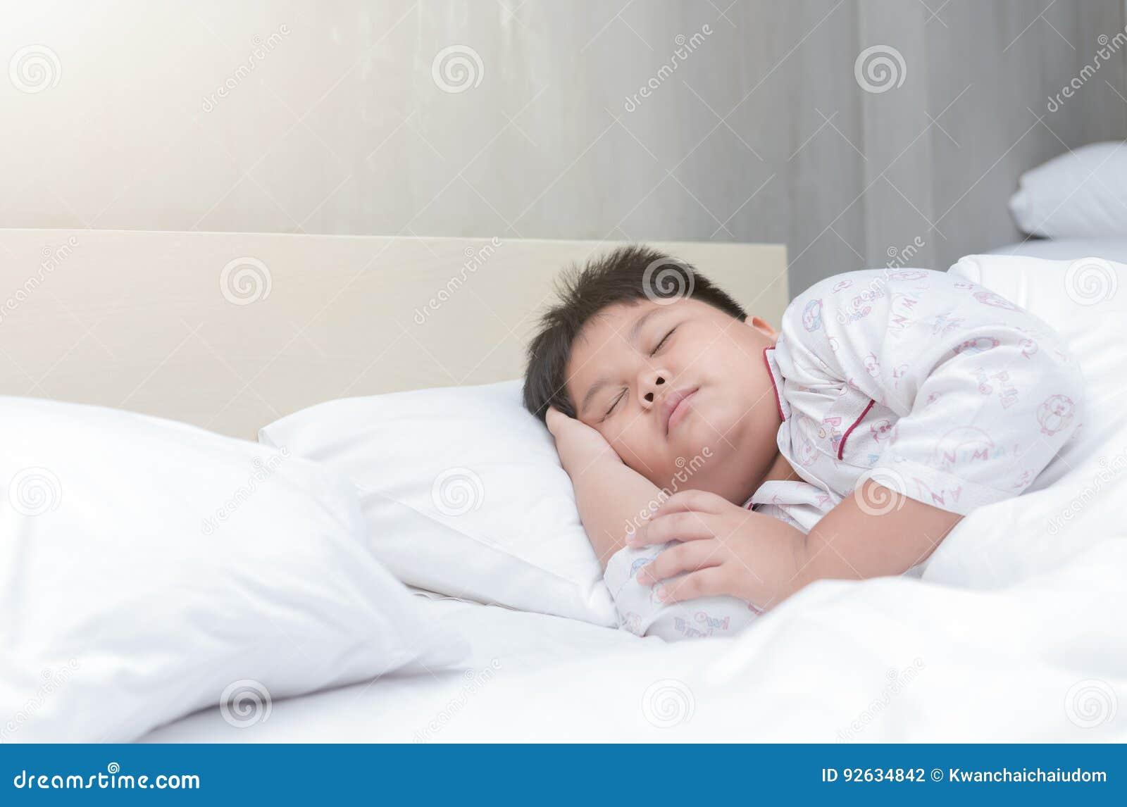 Fat boy sleep on bed
