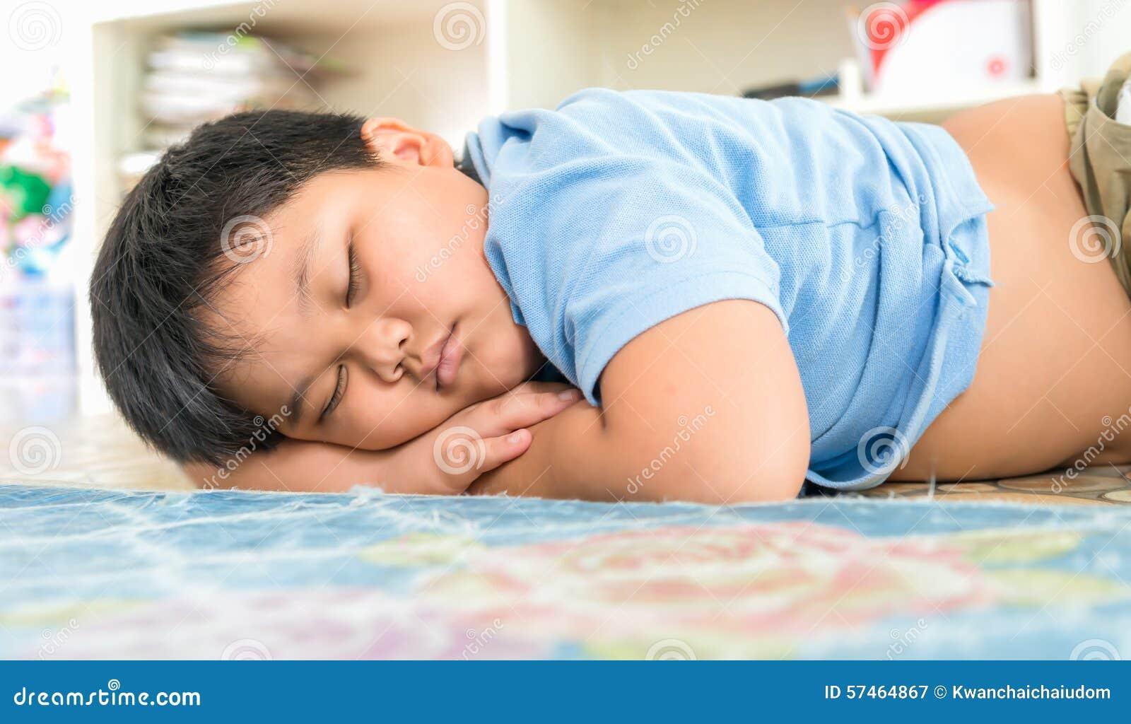 Fat boy sleep on his arm
