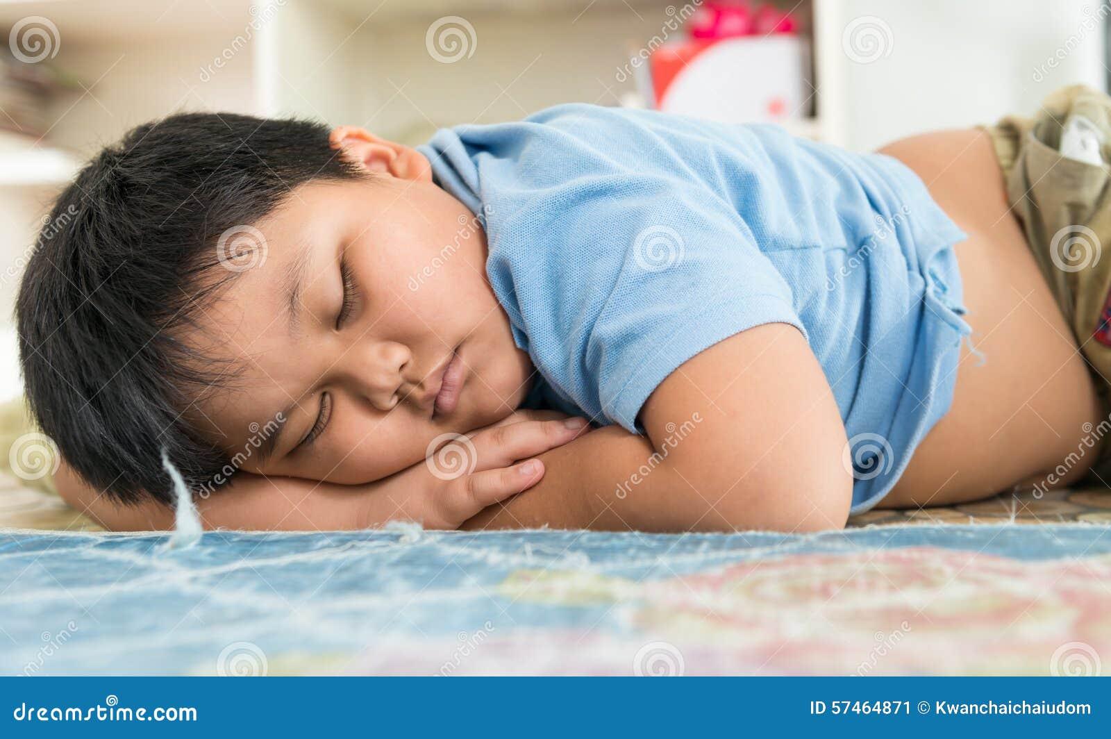 Fat boy sleep dream on his arm