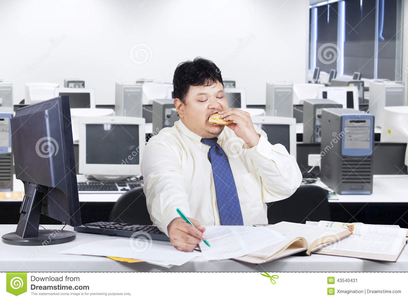 Fat Businessman Working While Eating Stock Photo