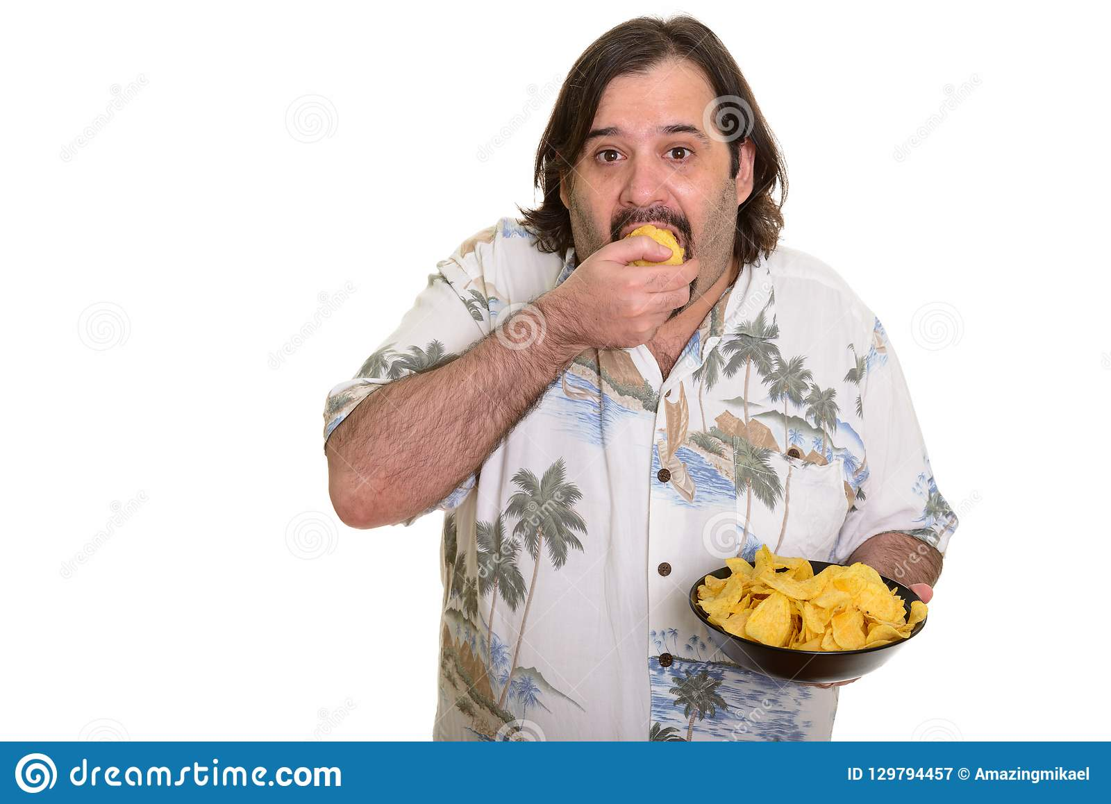 Fat Caucasian Man Eating Mouthful Of Chips Ready For