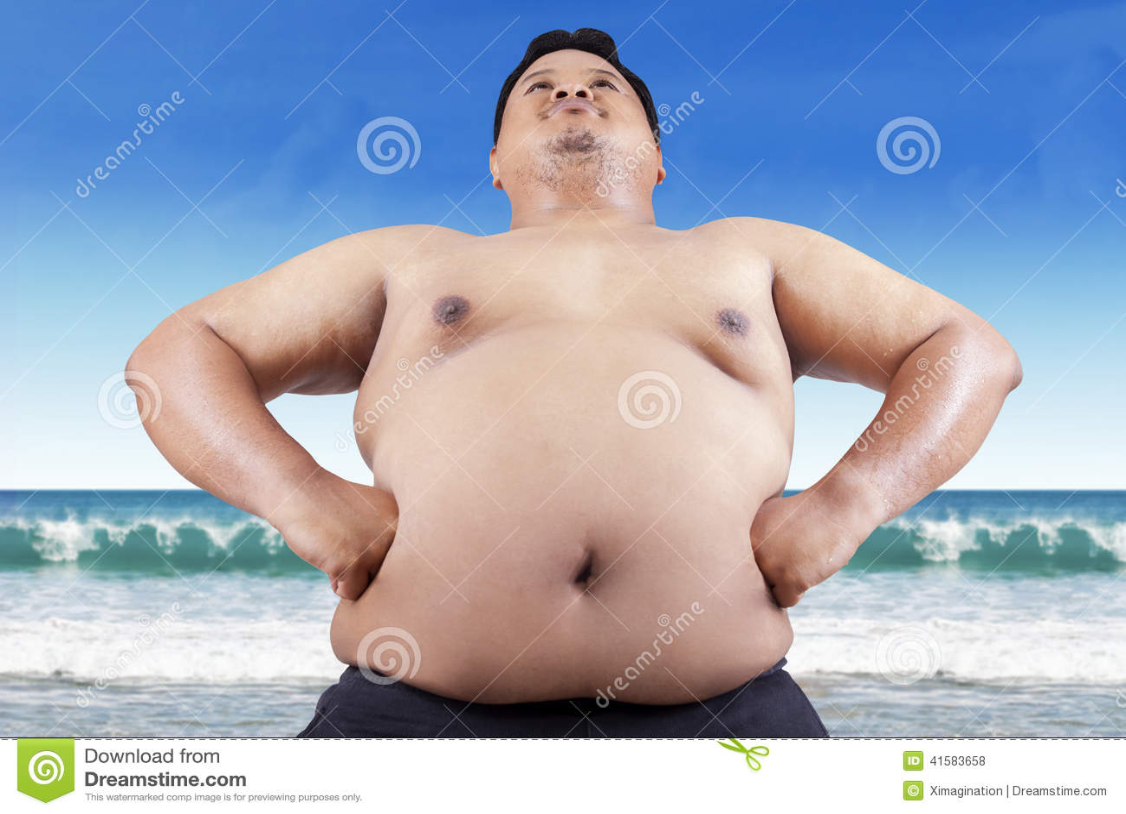 Fat men on beach