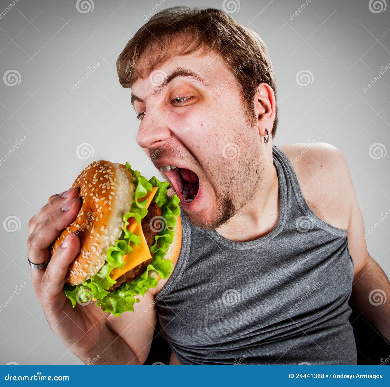 Fat Man Eating Hamburger Royalty Free Stock Photos - Image: 24441388
