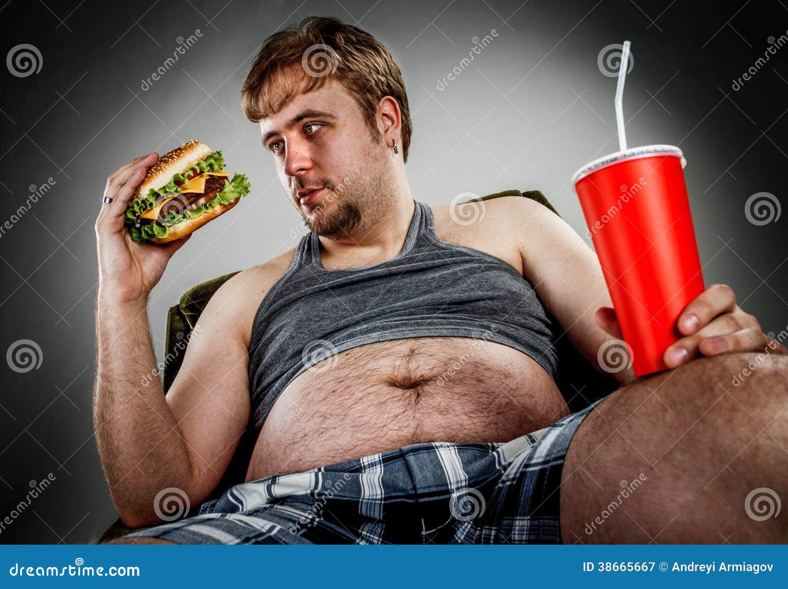 fat man eating hamburger royalty free stock photography