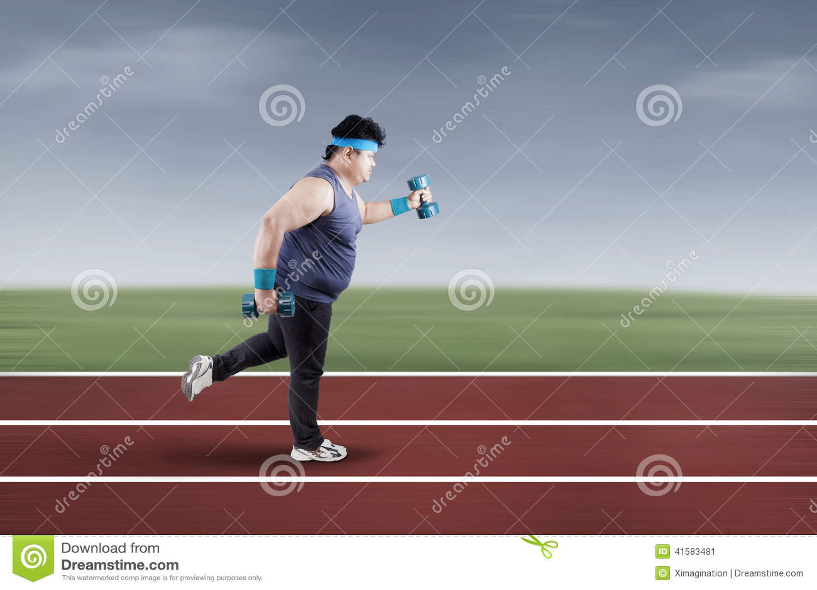 Fat Man Running On Track 1 Stock Photo - Image: 41583481