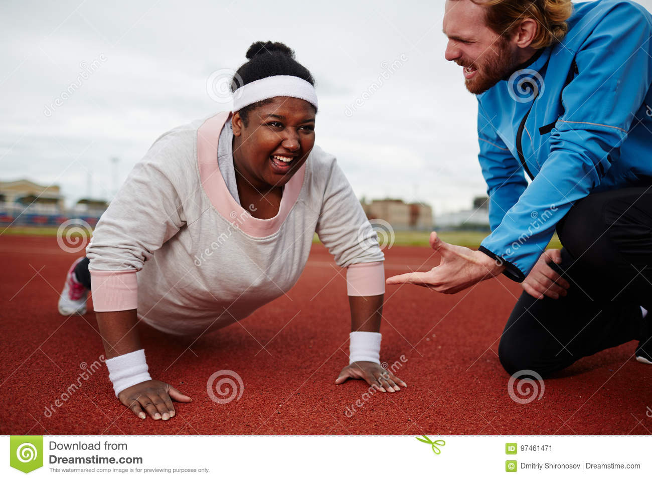 Fat Woman Doing Push Ups Motivated By Personal Coach Stock