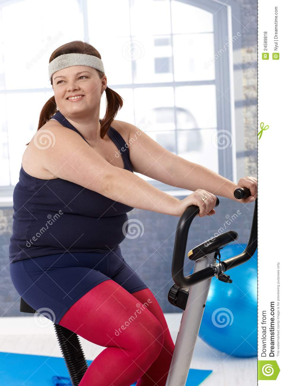 Fat woman on exercise bike
