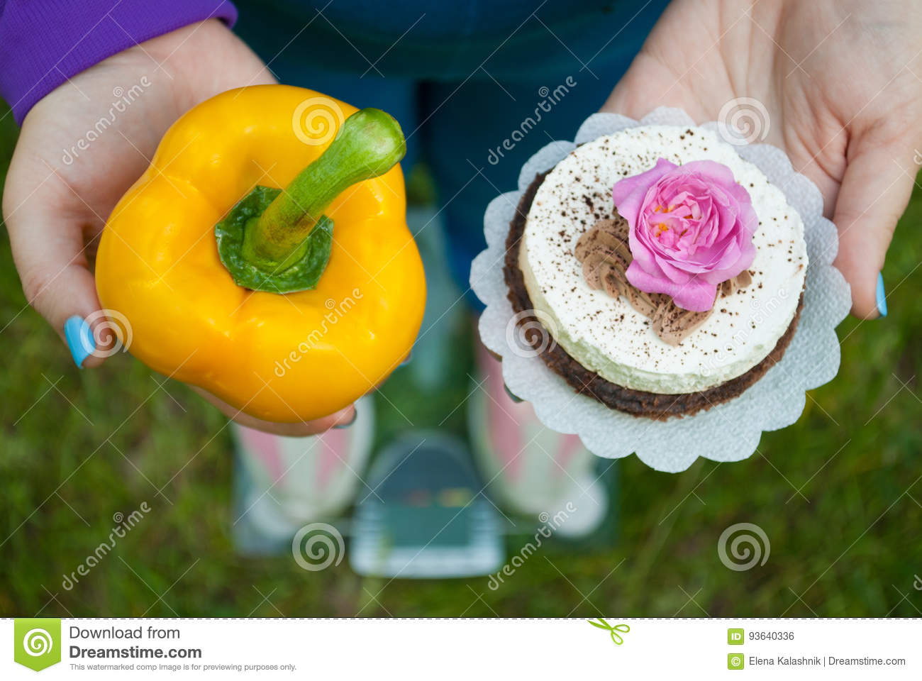 The fat woman is standing on the scales selects a yellow big sweet bell pepper