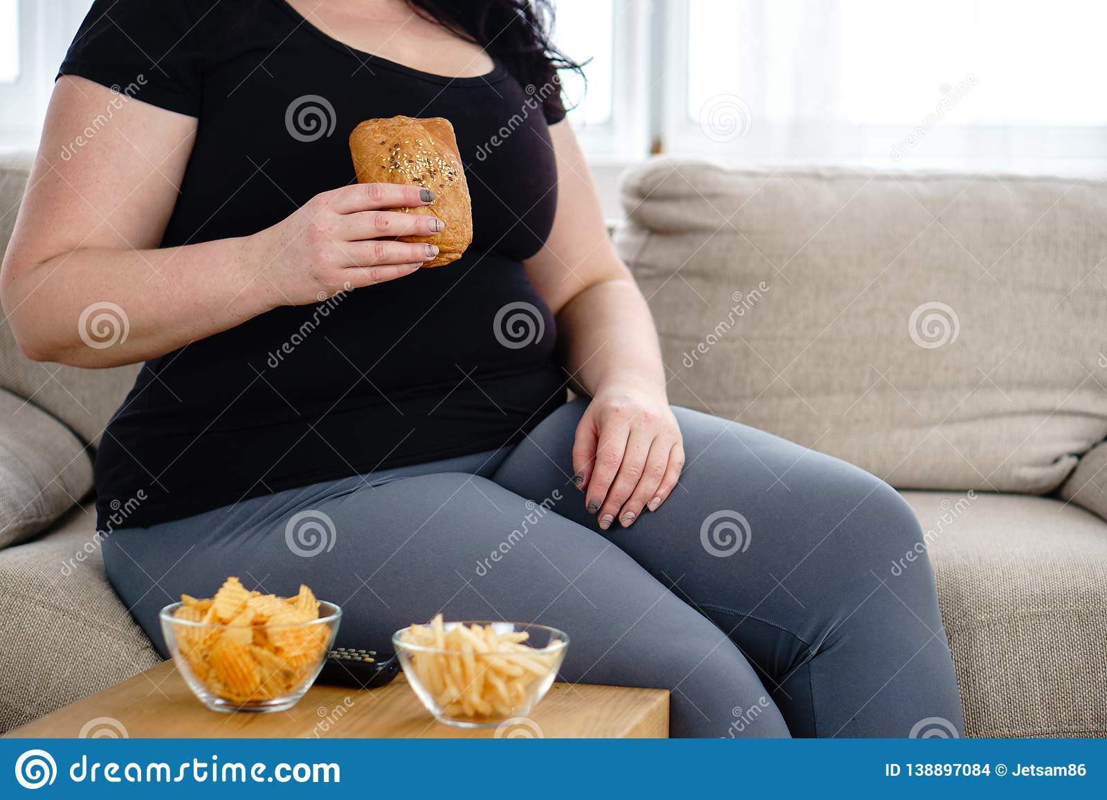 Serie Lack.Fat Woman Watching Series At Tv Eating Junk Food Stock Photo Image