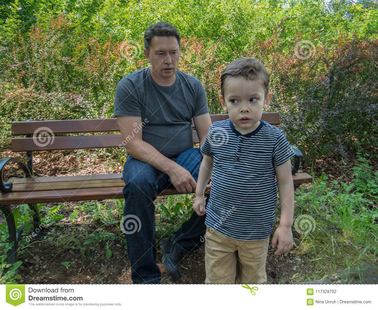 Father is aying something to his son going away but listening