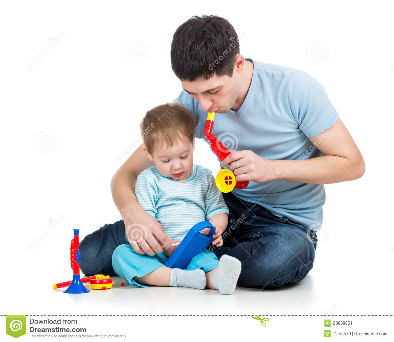 Boy Toys For Dads : Father and baby boy having fun with musical toys stock