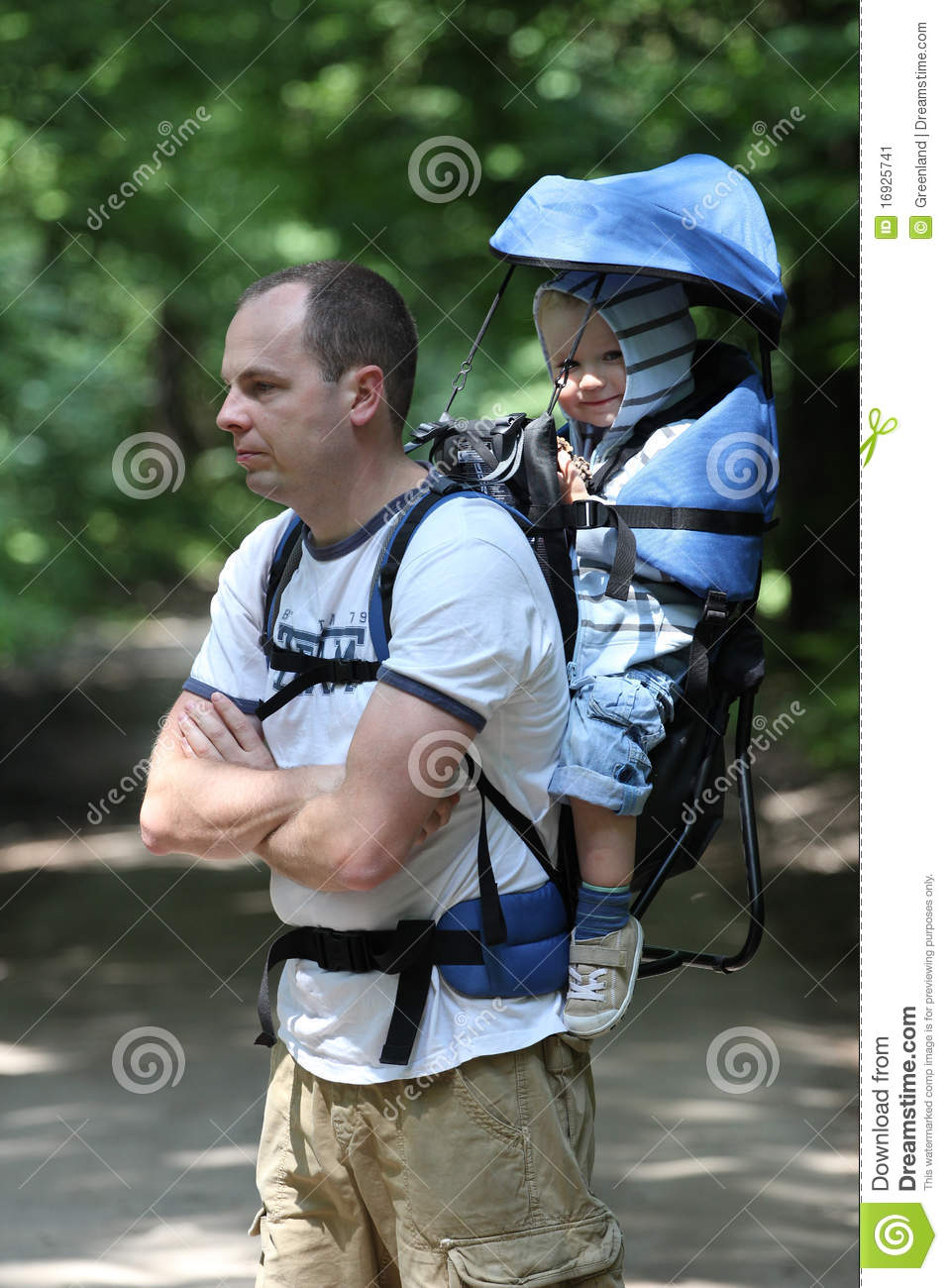 Father with baby in carrier stock image image 16925741 for Daddy carrier