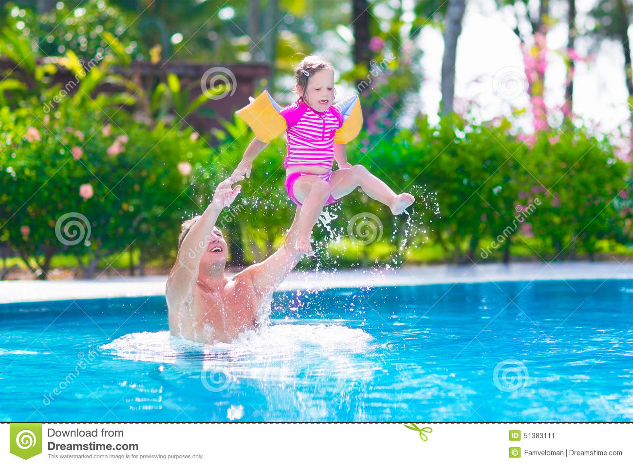 Father and baby girl playing in a swimming pool stock for Cute pool pictures