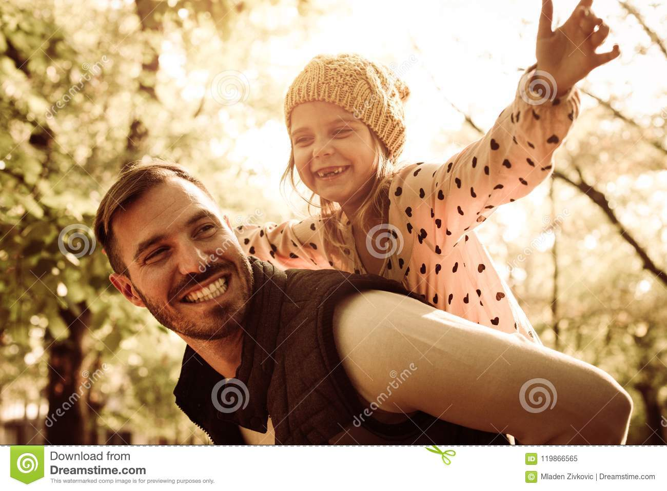 Father and daughter in park.