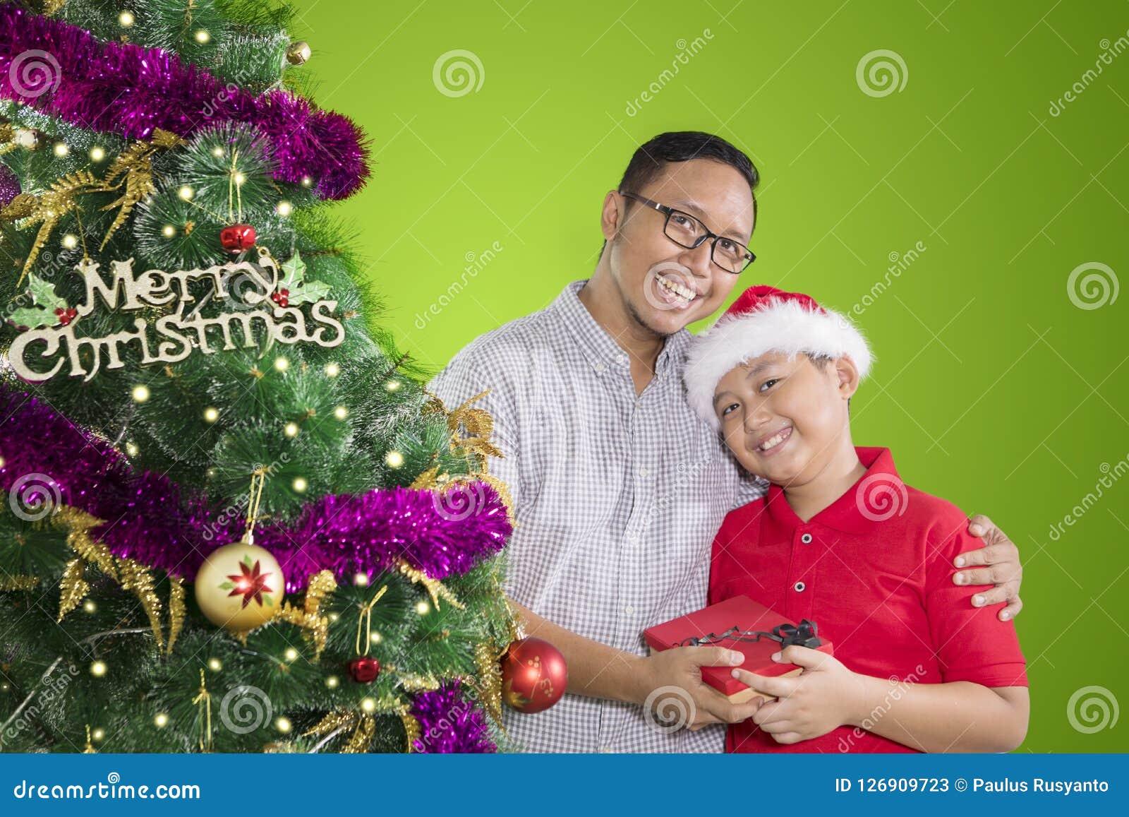 Father And Child Holding Christmas Gift Stock Image Image Of Present Christmas 126909723