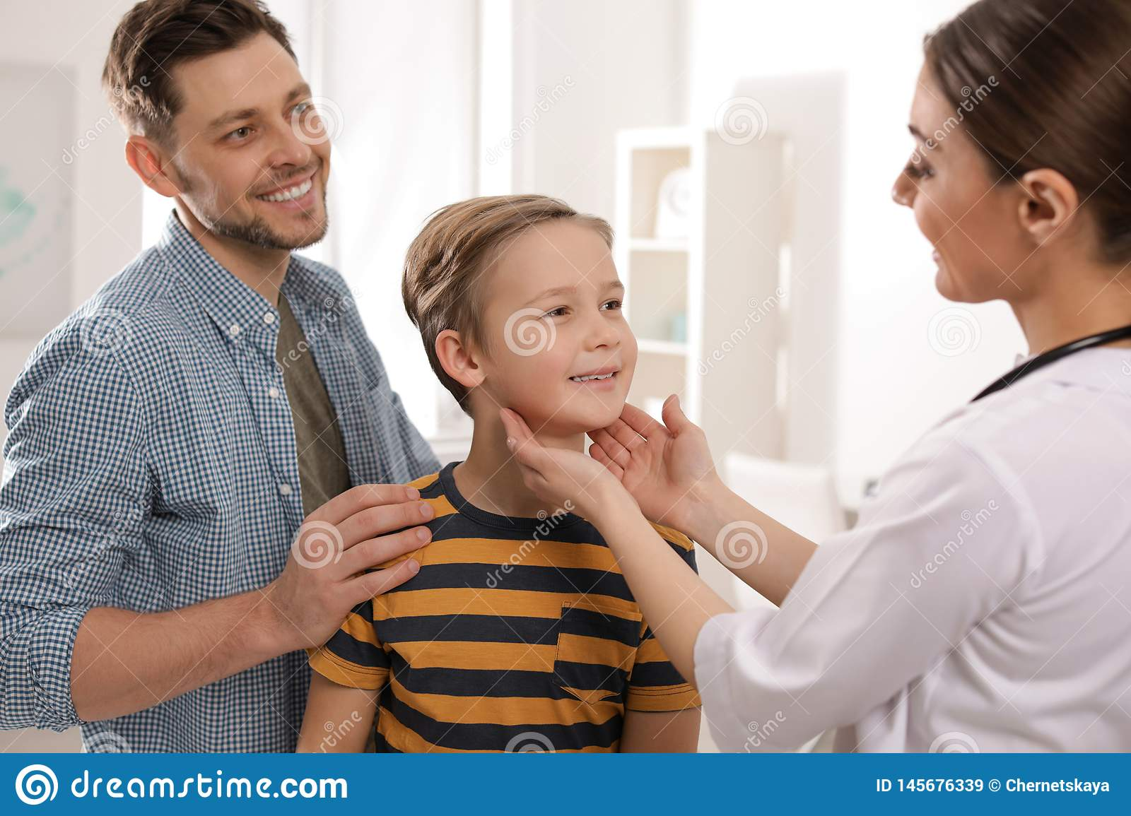 Father with child visiting doctor