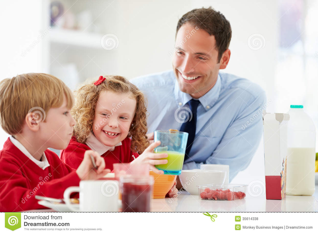 Father And Children Having Breakfast In Kitchen Together ...