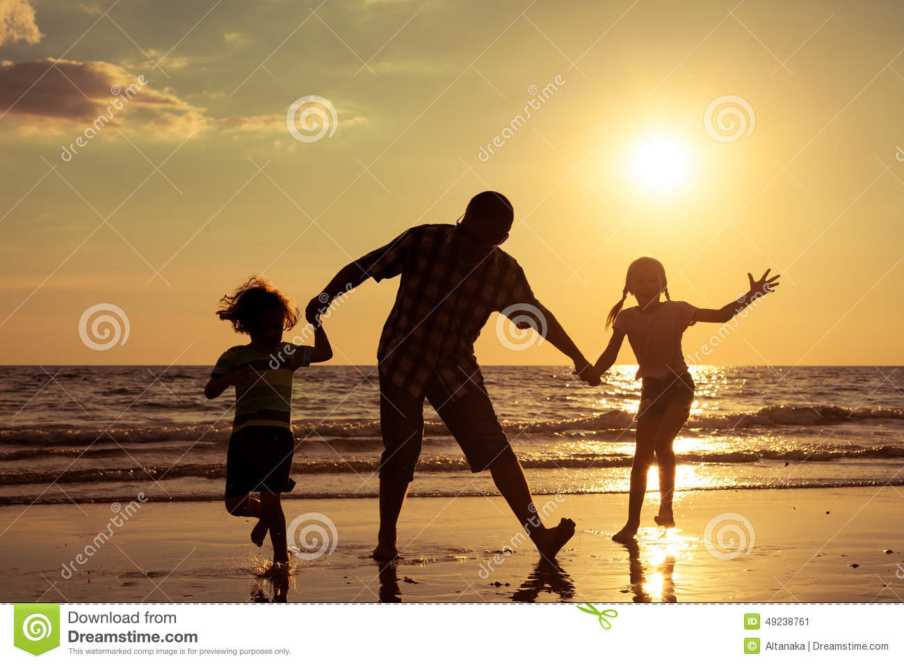Father And Children Playing On The Beach At The Sunset ...