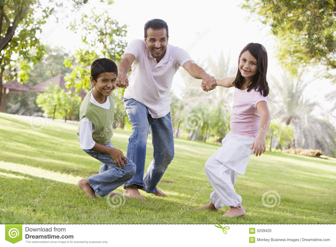 Father and children playing park