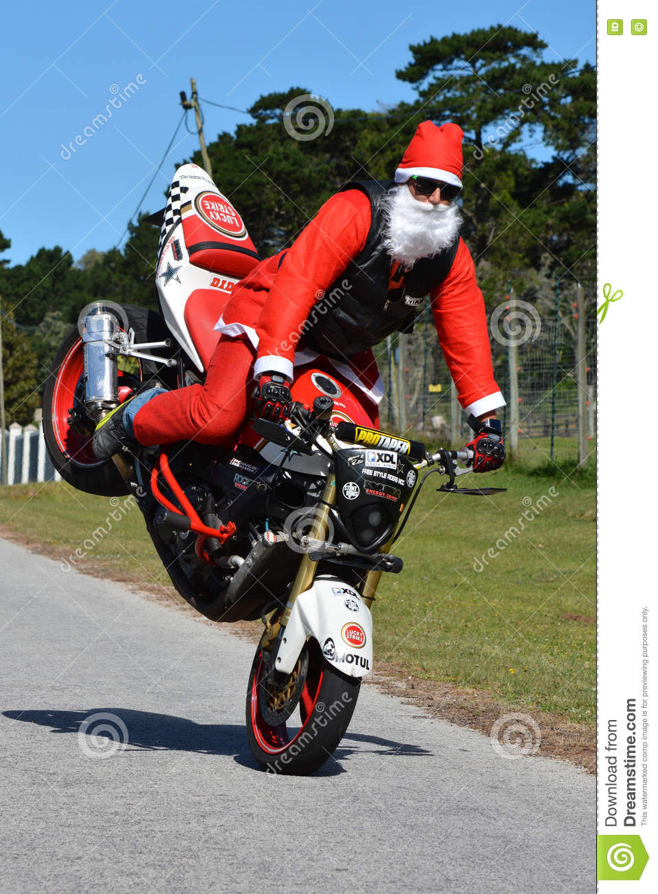 Father Christmas Doing Front Wheel Wheelie Editorial Image