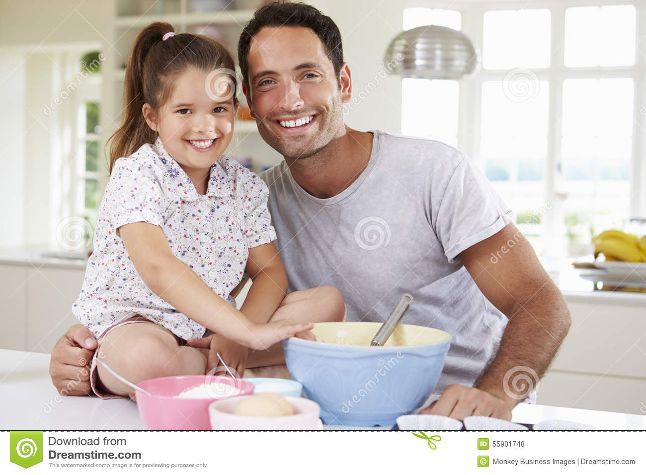 father and daughter baking cake in kitchen stock photo image of