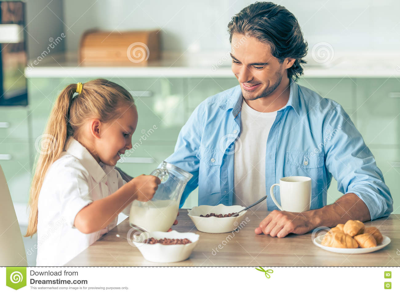 Father and daughter stock photo. Image of adult, croissant - 75461826