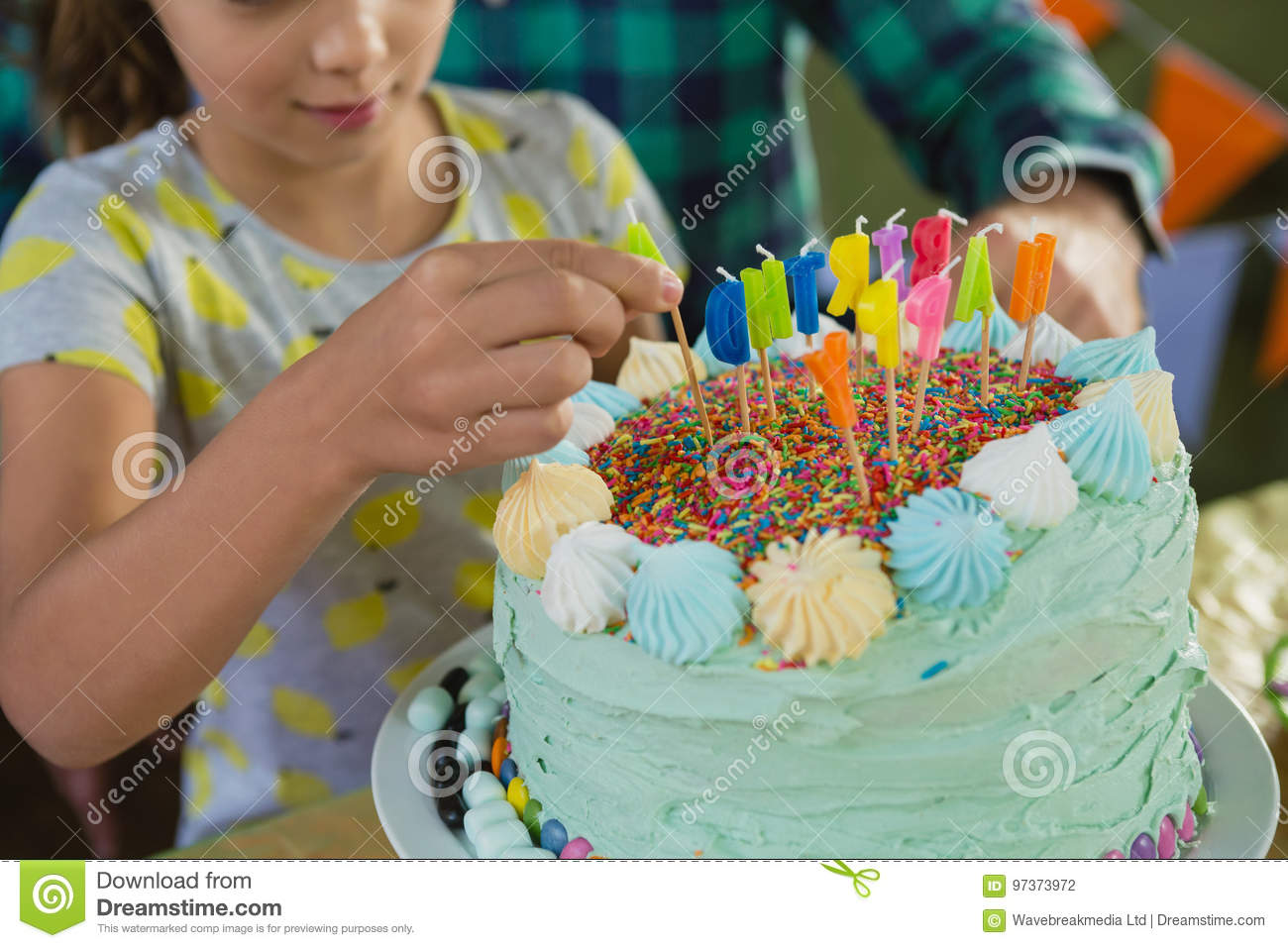 Father And Daughter Decorating Birthday Cake Stock Photo Image of