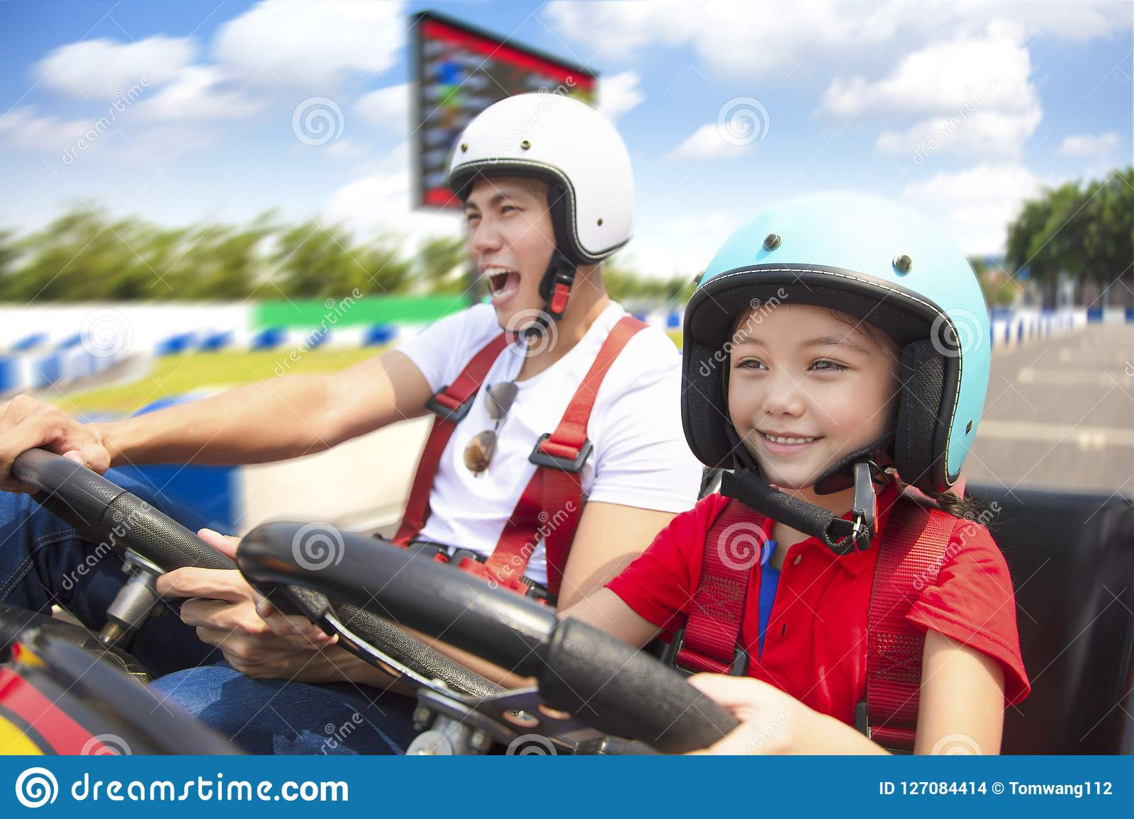 Father and daughter driving go kart