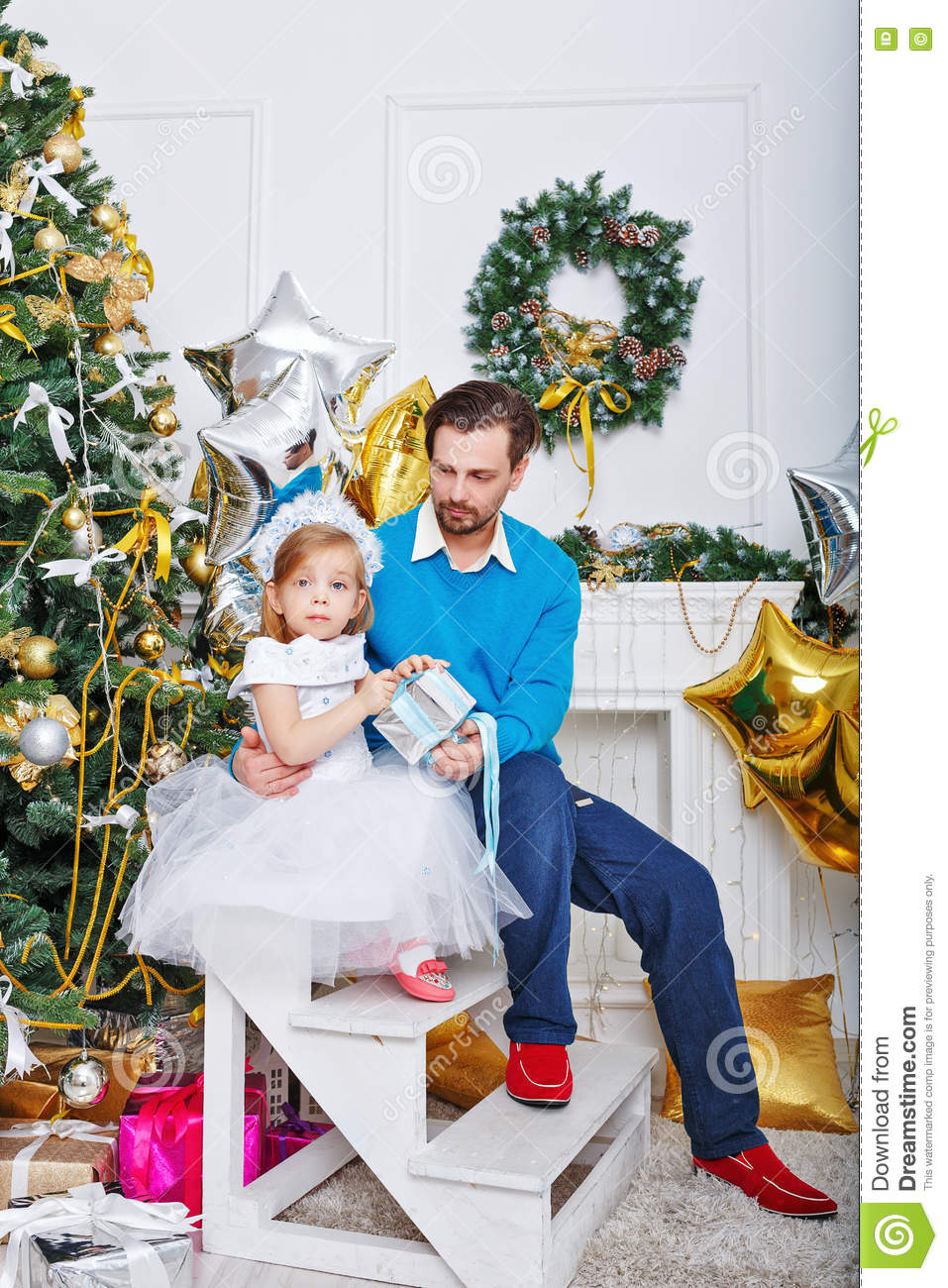 Father And Daughter With Gifts Near A Christmas Tree Stock Image