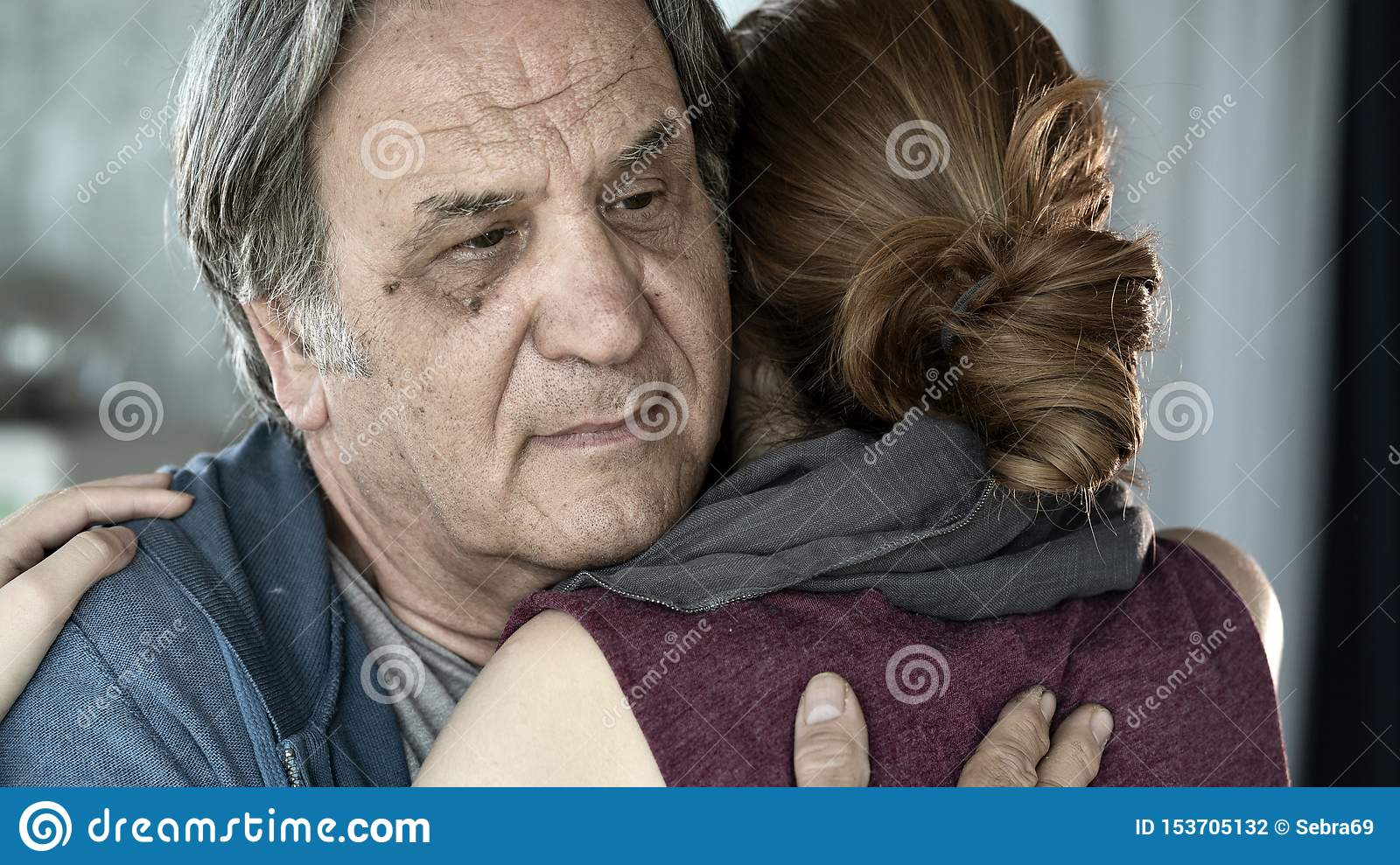 Father and daughter hugging close up view