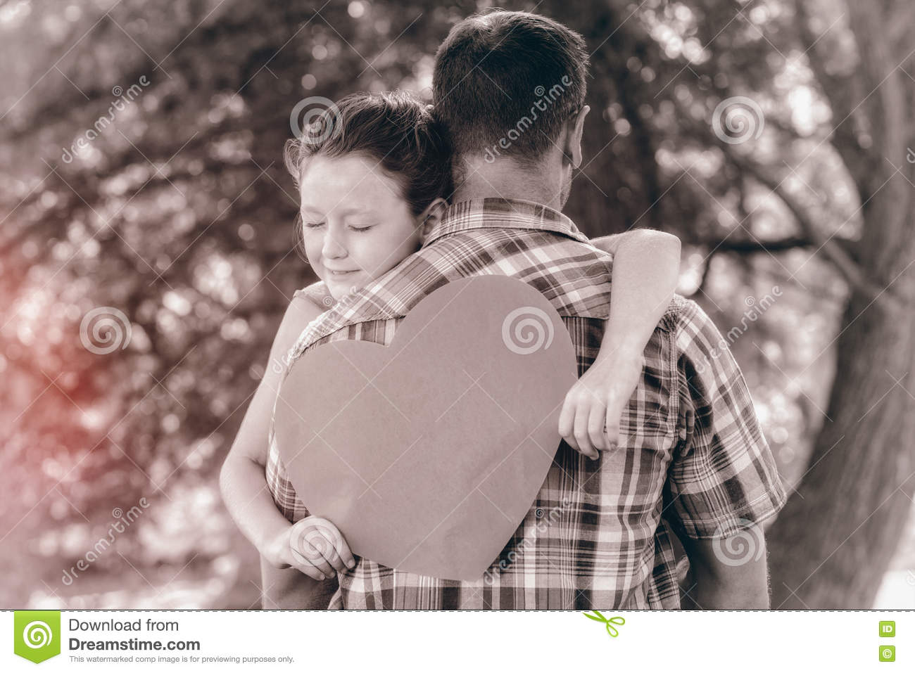 Father and daughter hugging in the park