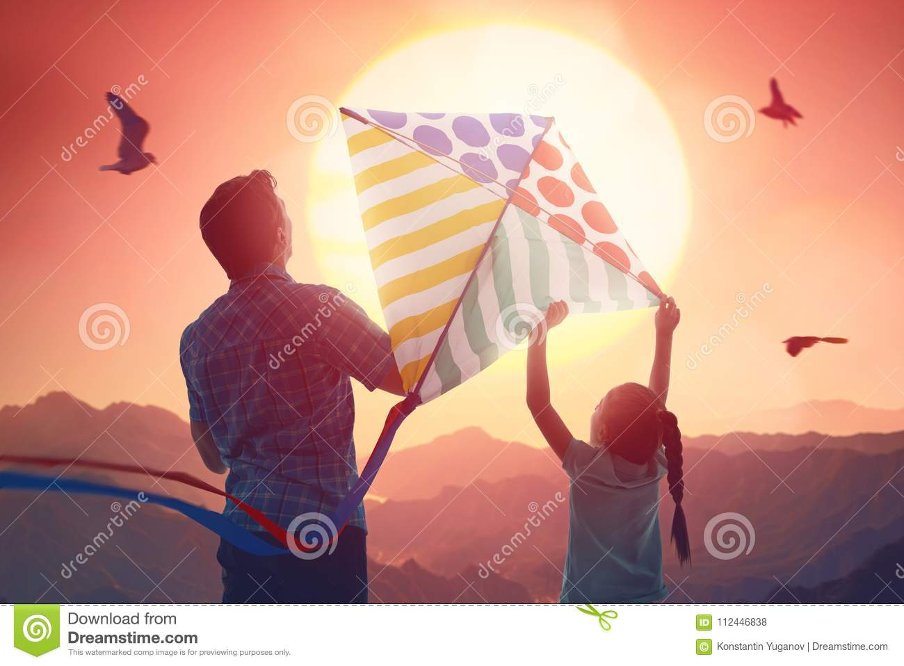 Father and daughter with kite