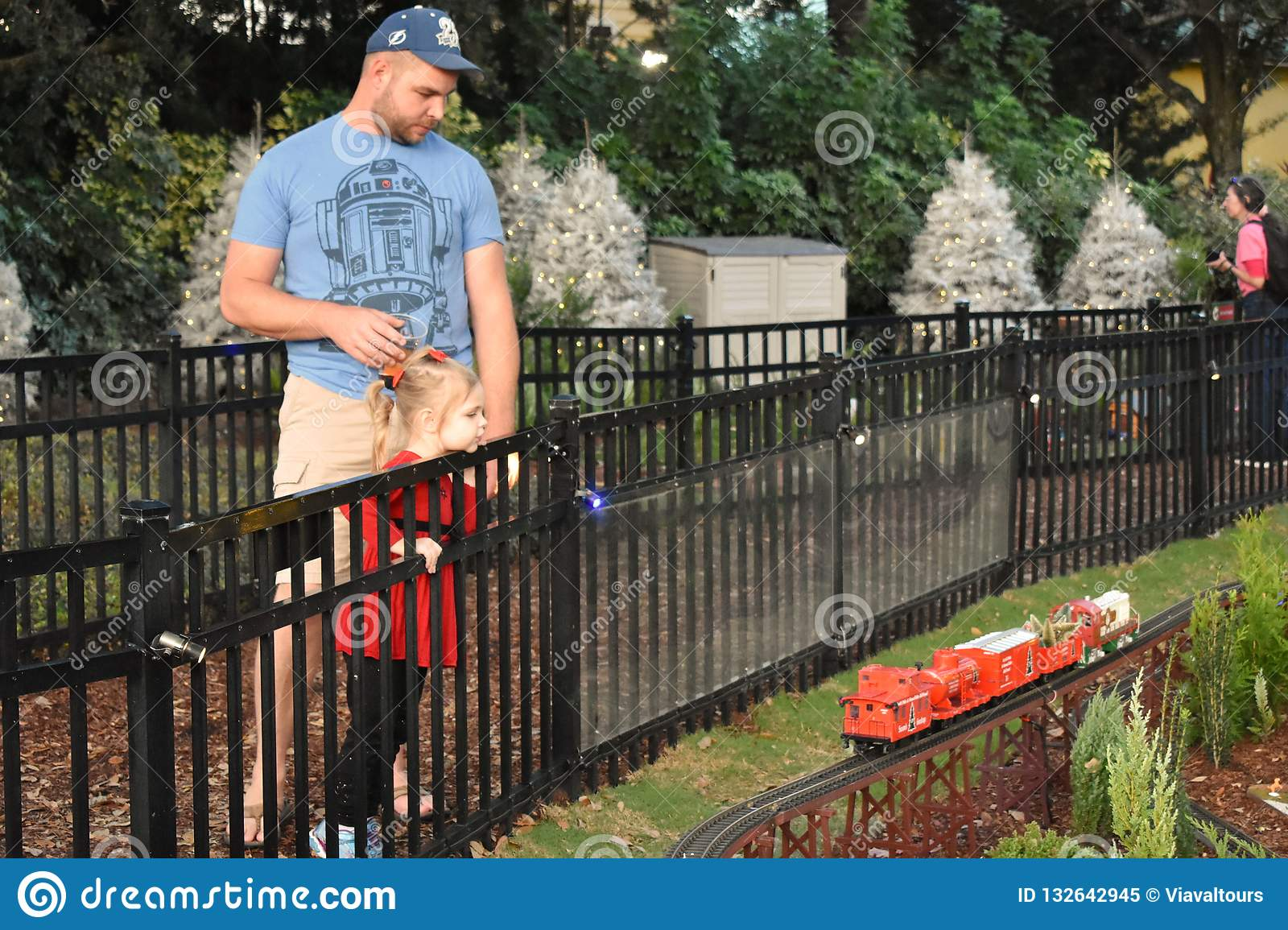 Father and daughter looking at miniature train in International Drive area.