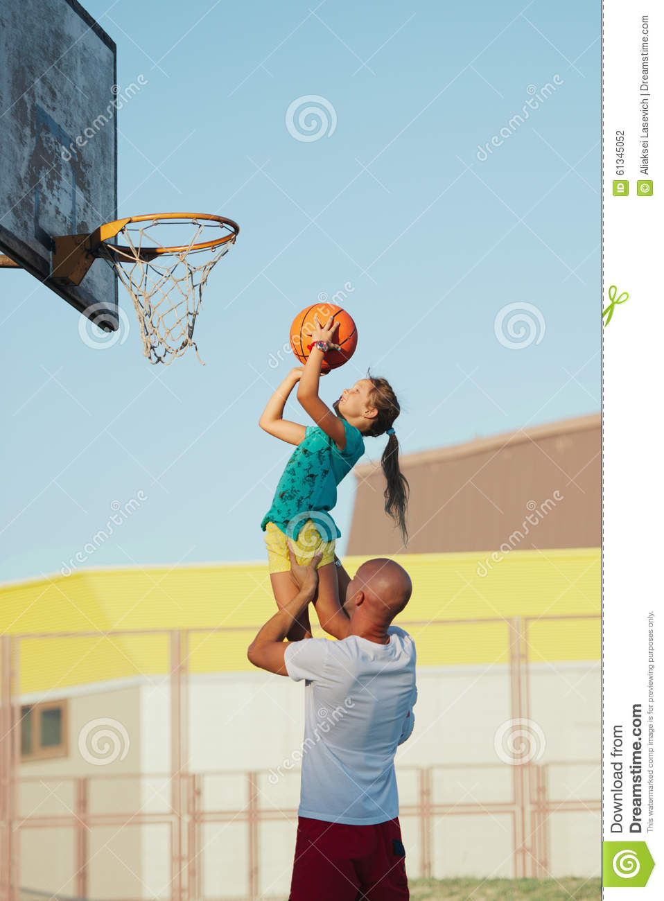 Father And Daughter Playing Basketball Stock Photo - Image ...
