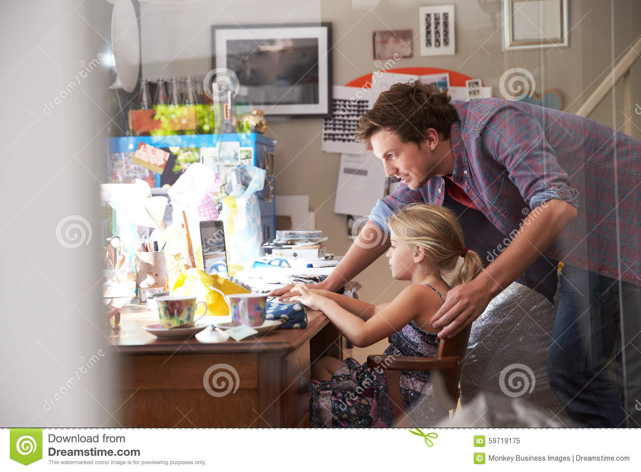 running home office. Father With Daughter Running Small Business From Home Office U