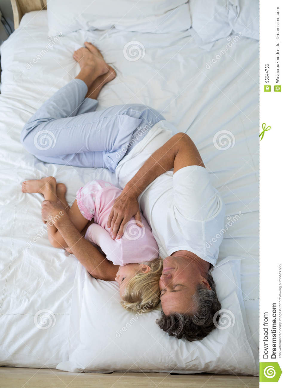 Father And Daughter Sleeping In Same Bed