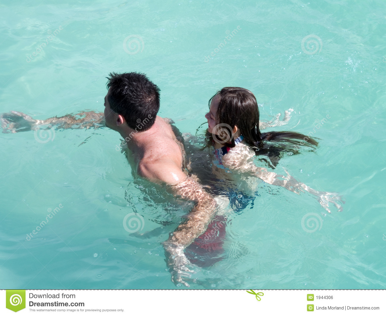 father and daughter swimming royalty free stock image