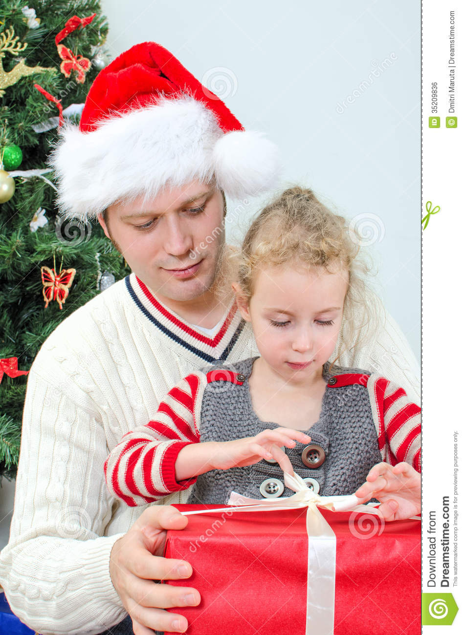 Father And Daughter Unpacking Gift Stock Photo - Image ...