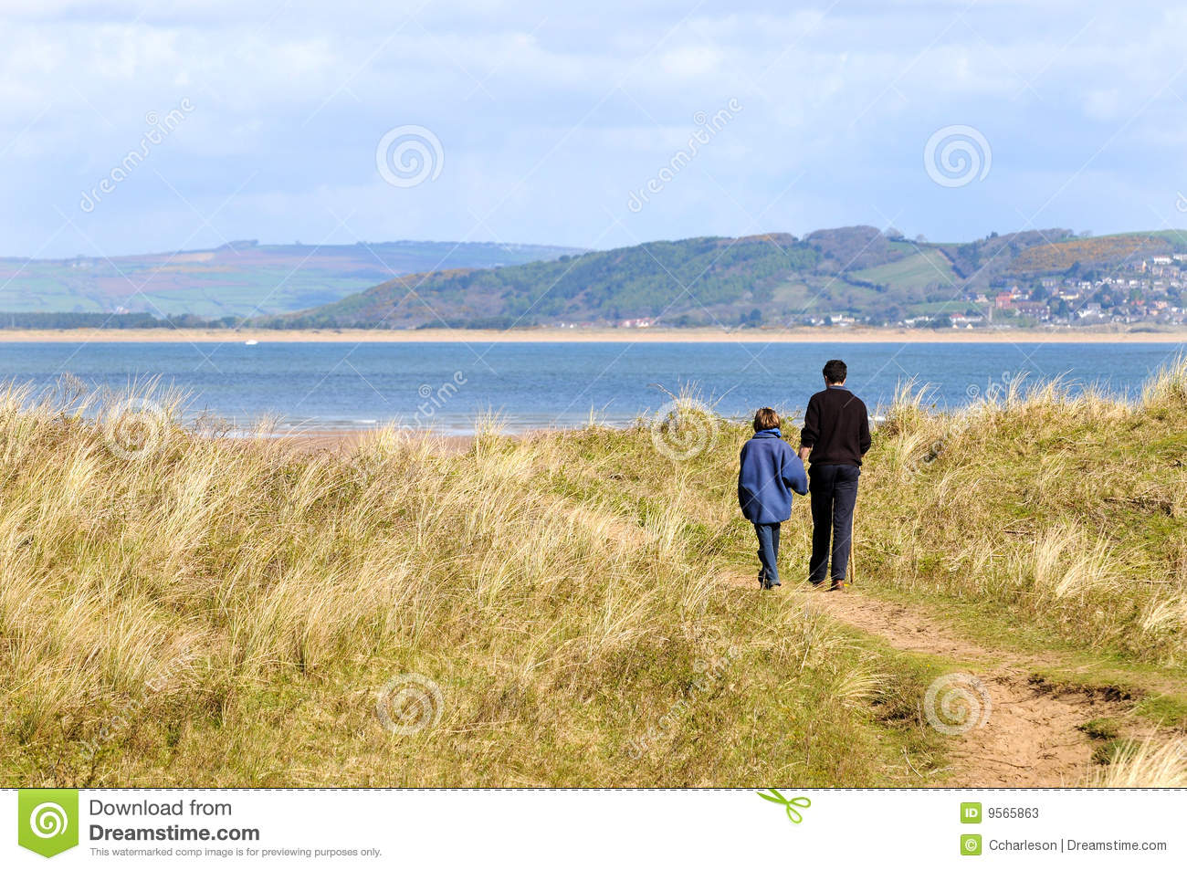 Father and daughter on walk along the coast