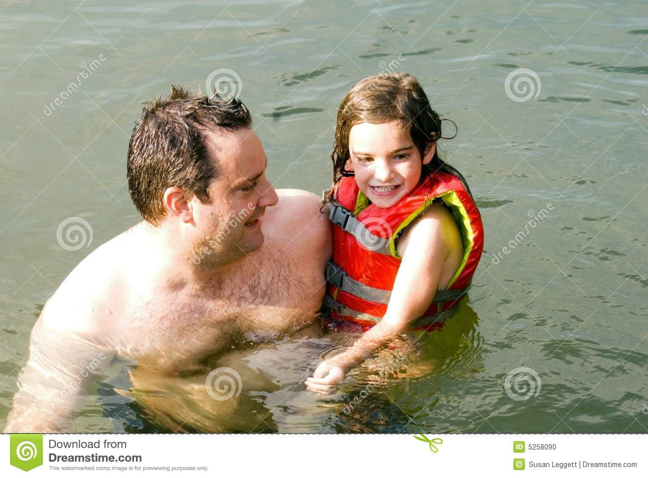 Father and Daughter in Water
