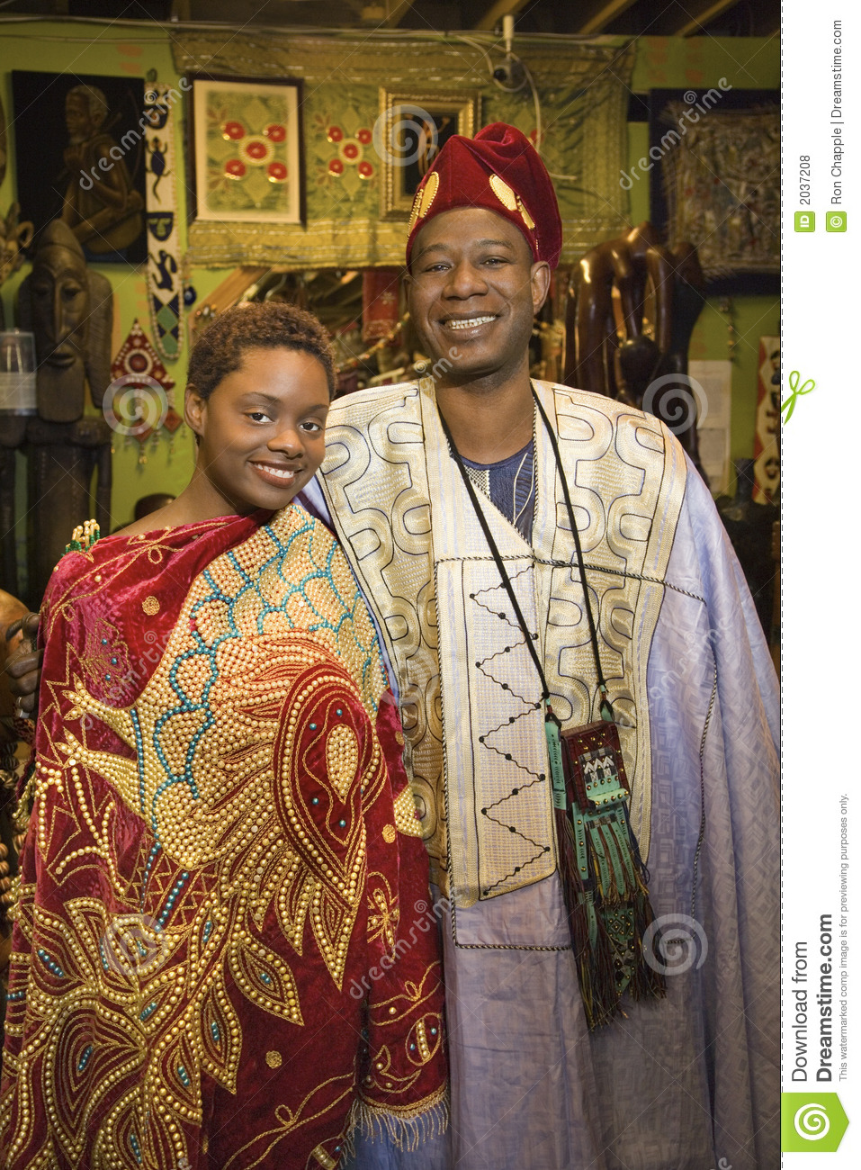 Father and daughter wearing African clot
