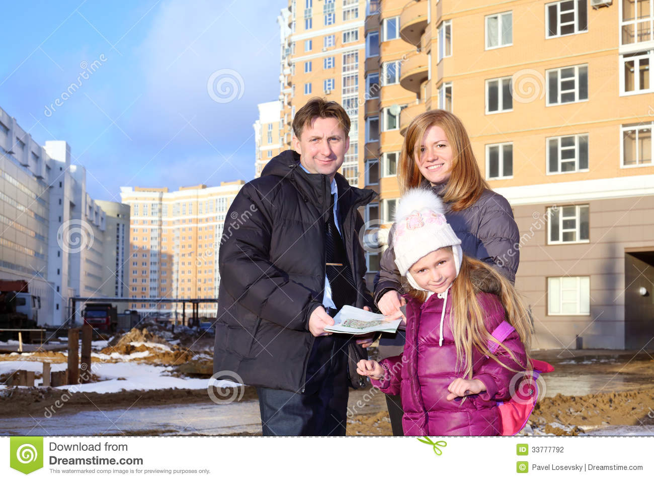 Father with drawings of apartments, daughter and realtor