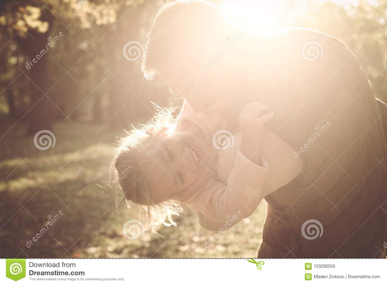 Father enjoying in autumn day with daughter
