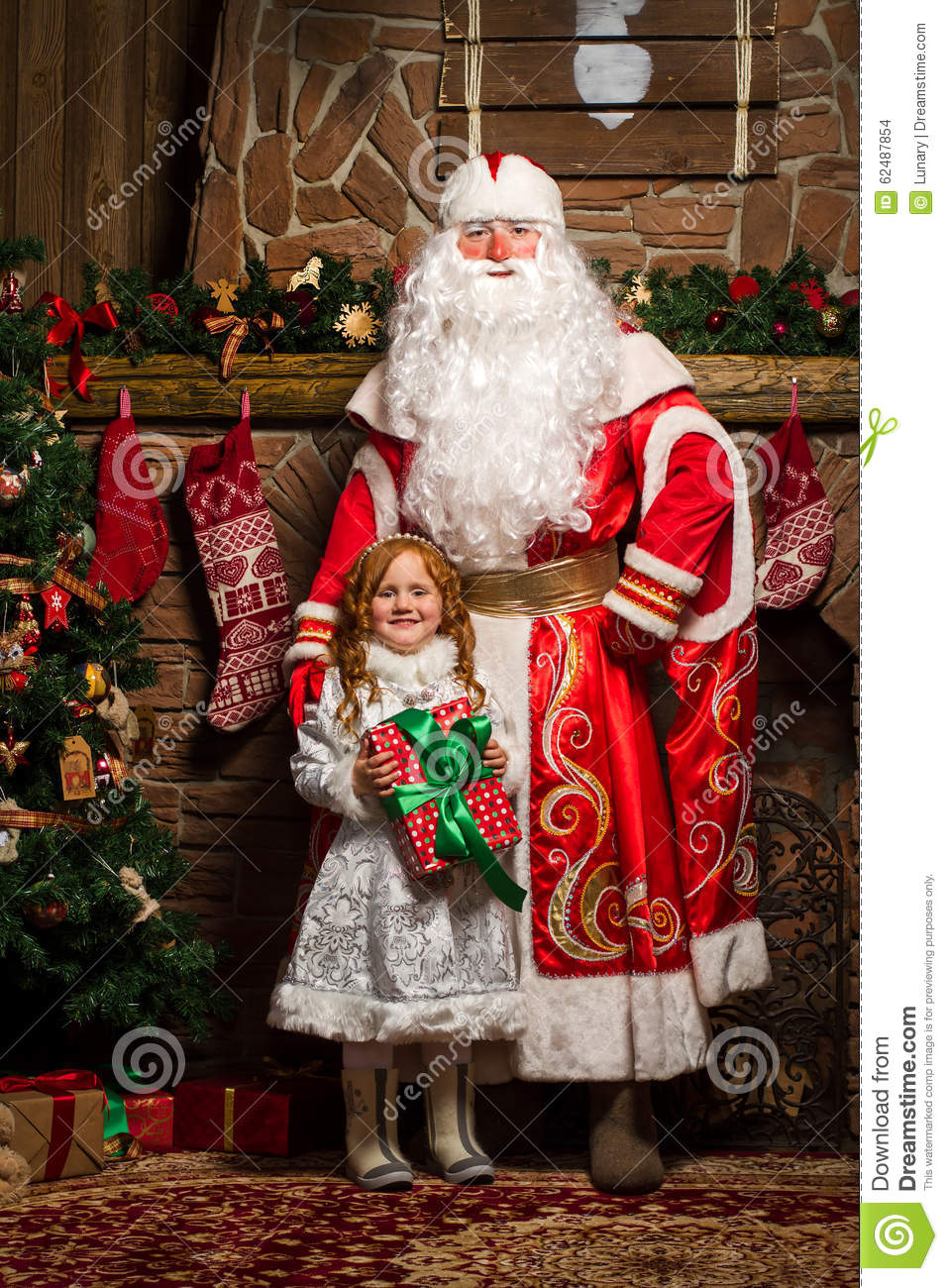 Father Frost And Snow Maiden Standing At The Christmas Tree With