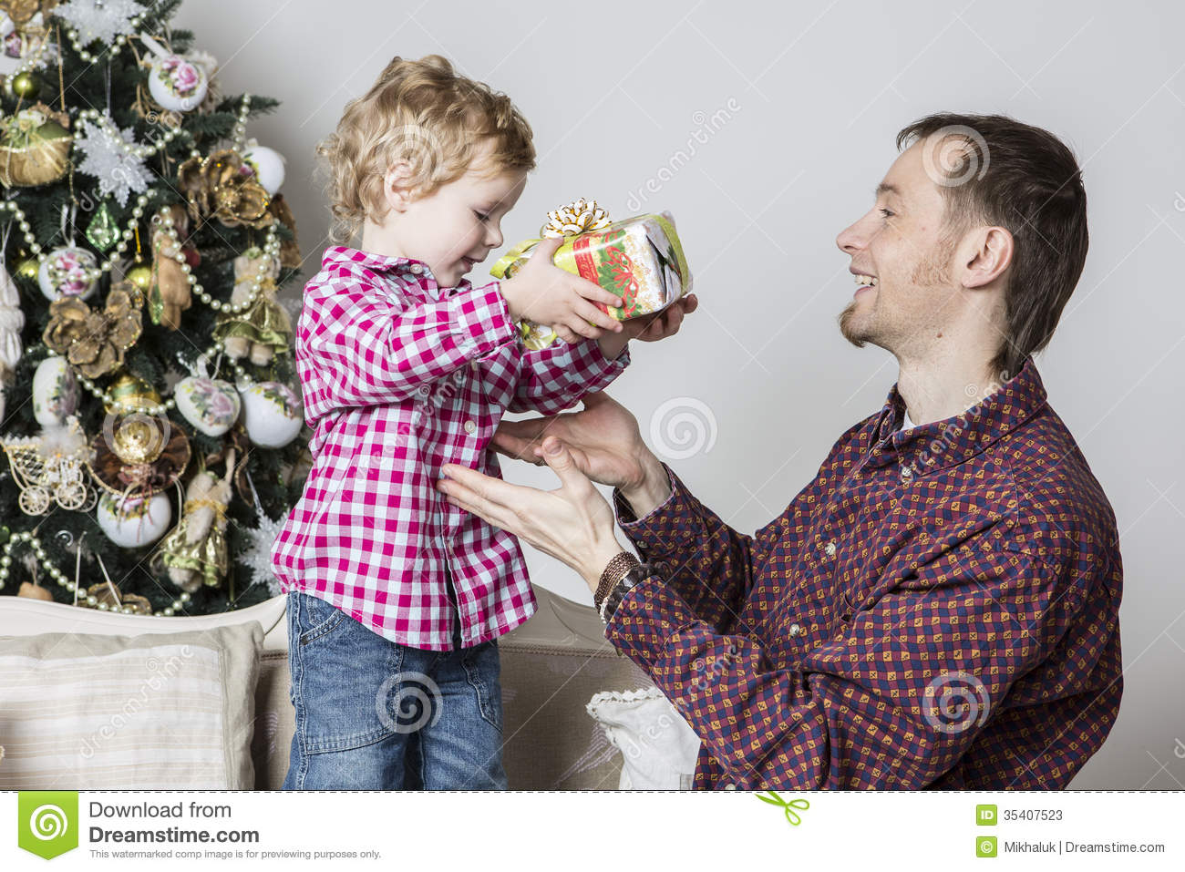 Father gives Christmas gift to his son